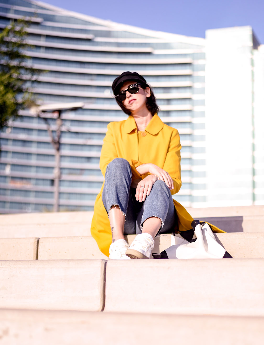 Just A Yellow Coat And A Pair Of White Sneakers