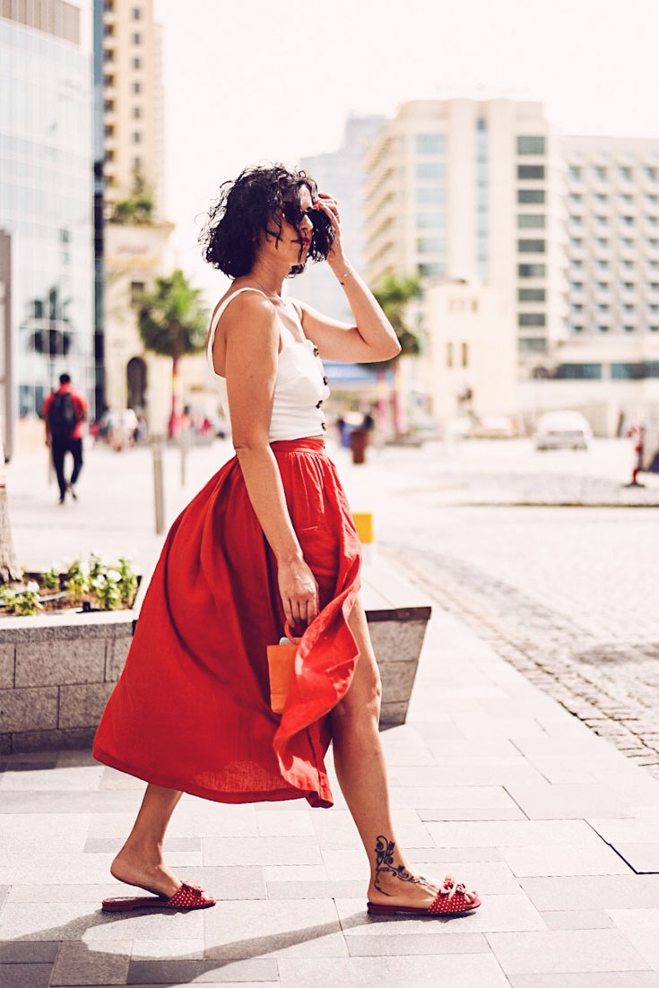Things I stopped worrying about on Bonjourchiara.com // Urban Outfitters cropped top and midi skirt , Simon Miller bucket bag, Tabitha Simmons shoes, Jimmy Choo cat-eye sunglasses #summerlook #empowerwomen #loveyourbody #bucketbag